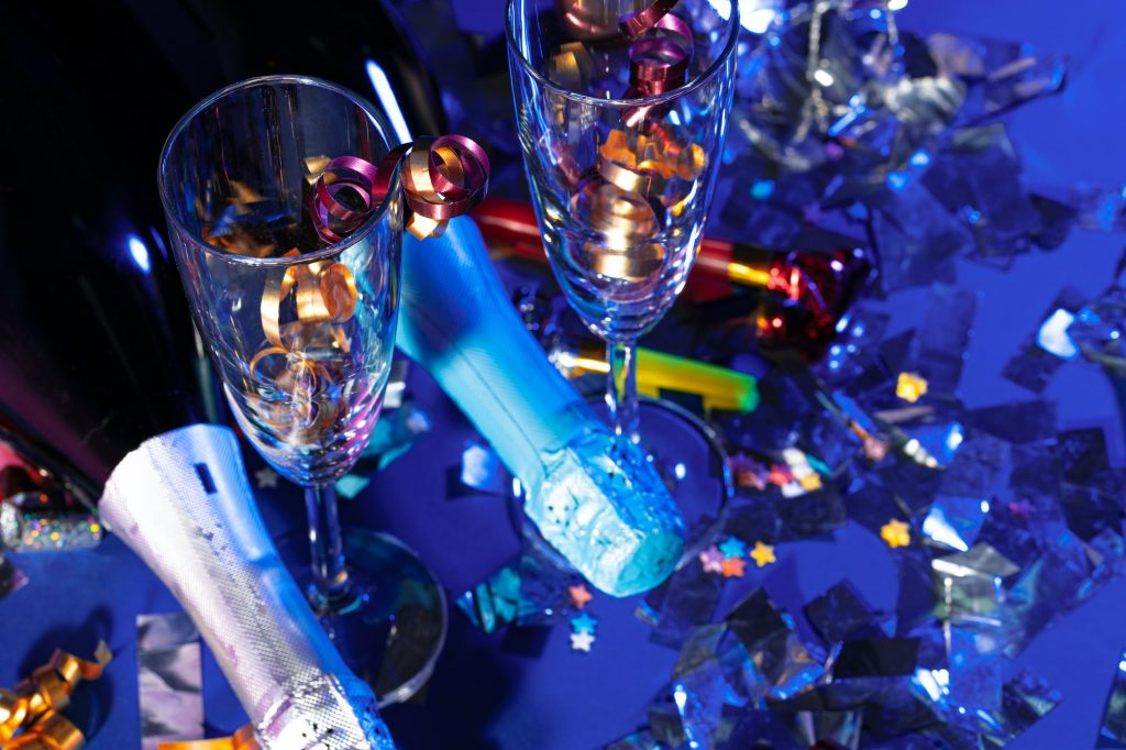 Champagne bottle on a purple background close up. Party concept